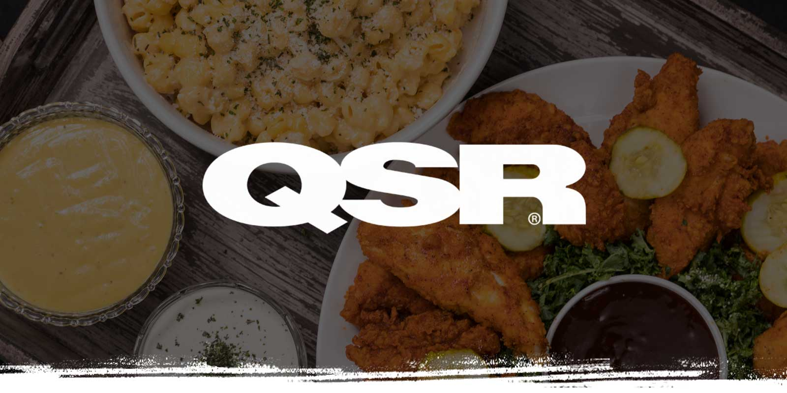 QSR logo on catering table background